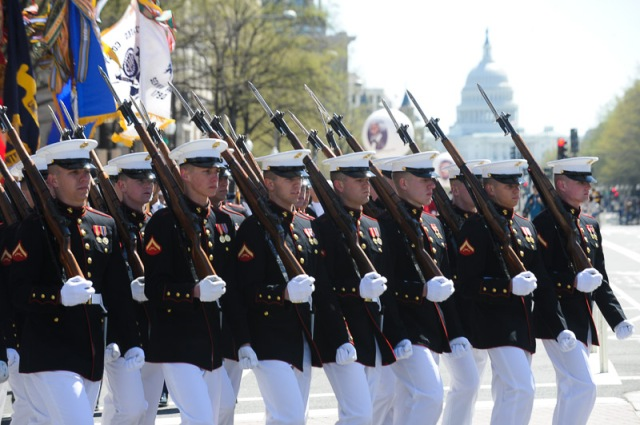 Members of the US Military march down Pennsylvania Avenue during the Emancipation Day Parade.