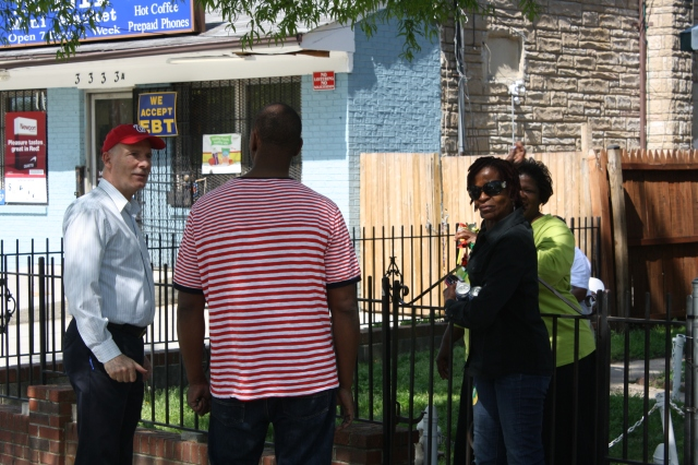 Phil stops to ask some Congress Heights residents for directions to the new G8Way Pavilion.