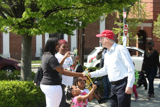Phil shaking hands and making friends along the parade route on Congress Heights Day.