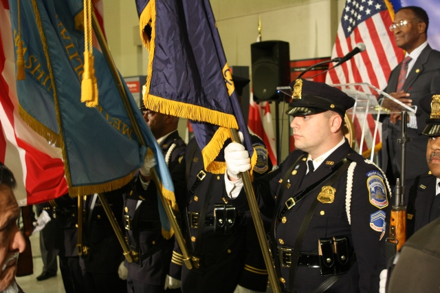 Members of MPD's Honor Guard present flags before Tuesday night's ceremonies.